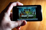 "An image of the popular video game ""Angry Birds"" is displayed on an iPod Touch, 2011. Rovio, the Finnish makers of the world's most-downloaded mobile app ""Angry Birds"", will seek a stock market listing by the end of 2013, chief financial officer Mikko Setala said in an interview"