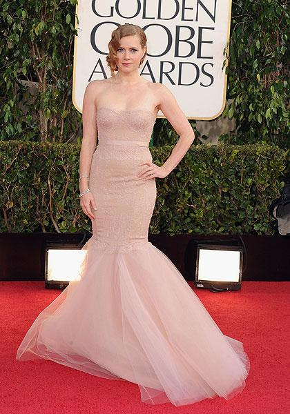 Amy Adams: 'The Master' star and Golden Globe nominee looks as if she could disappear in her nude-colour Marchesa gown. If it were any other colour, say emerald green or a deep blue, it would look spe