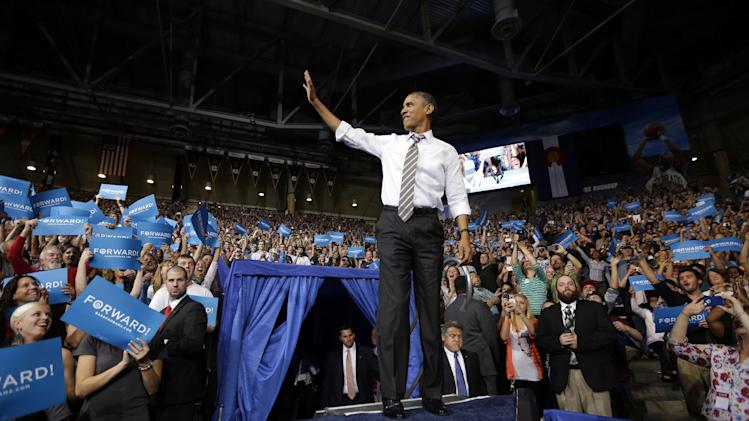 President Barack Obama waves to supporters as he is introduced at a campaign event at the University of Colorado - Boulder, Thursday, Nov. 1, 2012, in Boulder Colo. (AP Photo/Pablo Martinez Monsivais)