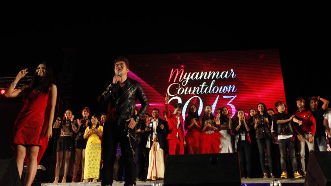 Myanmar actors welcome the New Year at the first ever public New Year Countdown at Myoma grounds in Yangon, Monday, Dec. 31, 2012, in Yangon, Myanmar. (AP Photo/Khin Maung Win)