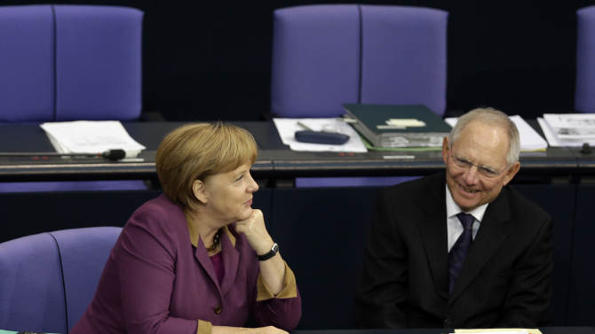 FILE - The Nov. 30, 2012 file photo shows German Chancellor Angela Merkel, left, and German Finance Minister Wolfgang Schaeuble, right, during a meeting of the German federal parliament, Bundestag, in Berlin, Germany. By rejecting an EU bailout and turning to Russia for help, Cyprus is exposing growing frustration and dwindling solidarity within a bloc that was meant to bring the continent closer together after World War II. The chaos over the rescue plan, which the Cypriot parliament roundly rejected Tuesday, has renewed many of doubts about the legitimacy of the European project _ notably over perceived German dominance and threats to national sovereignty. The extraordinary spectacle of an EU member seeking salvation from the old Cold War enemy has raised deep questions about how far Europe can and will go to take care of its own.  (AP Photo/Michael Sohn)