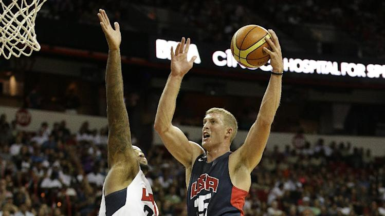 Brooklyn Nets' Mason Plumlee, right, goes up for a shot against Sacramento Kings' DeMarcus Cousins during the USA Basketball Showcase game Friday, Aug. 1, 2014, in Las Vegas. (AP Photo/John Locher)