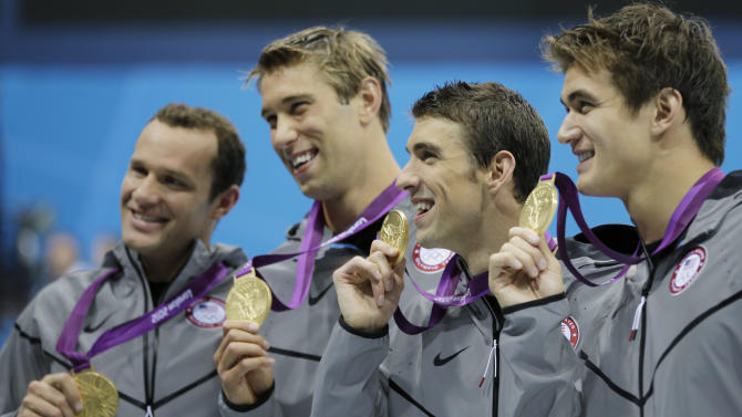 United States' men's 4 X 100-meter medley relay team from left, Brendan Hansen, Matthew Grevers, Michael Phelps and Nathan Adrian hold their gold medals at the Aquatics Centre in the Olympic Park during the 2012 Summer Olympics in London, Saturday, Aug. 4, 2012. (AP Photo/Matt Slocum)