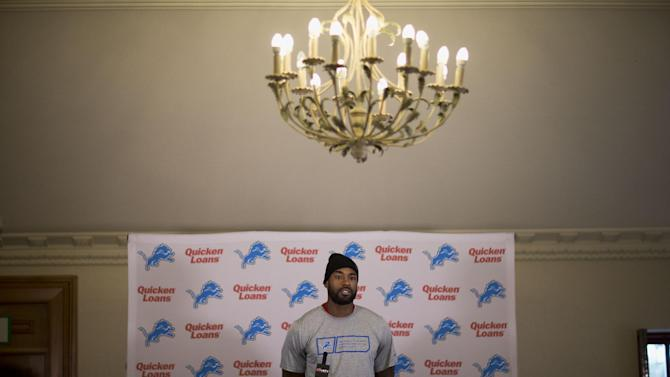 Detroit Lions wide receiver Calvin Johnson speaks during a press conference at Pennyhill Park Hotel in Bagshot, England, Thursday, Oct. 23, 2014.  The Atlanta Falcons will play the Detroit Lions in an NFL football game at London's Wembley Stadium on Sunday