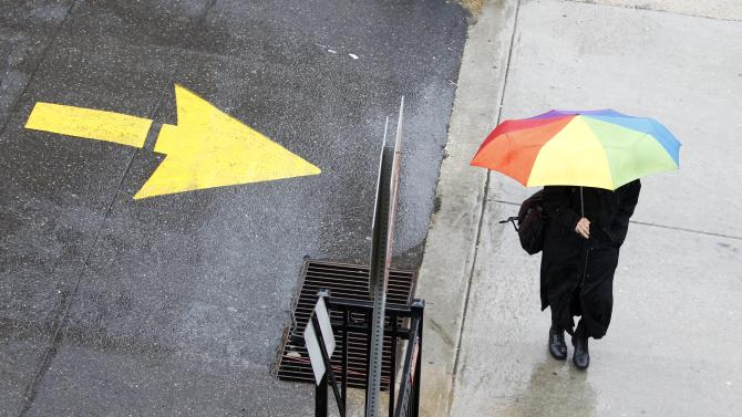 A pedestrian shields herself from the weather with an umbrella during a rainstorm in Philadelphia, Thursday, March 10, 2011. Flood watches are in effect across much of Pennsylvania as rain moves into the state, threatening to raise already swollen waterways out of their banks. (AP Photo/Matt Rourke)