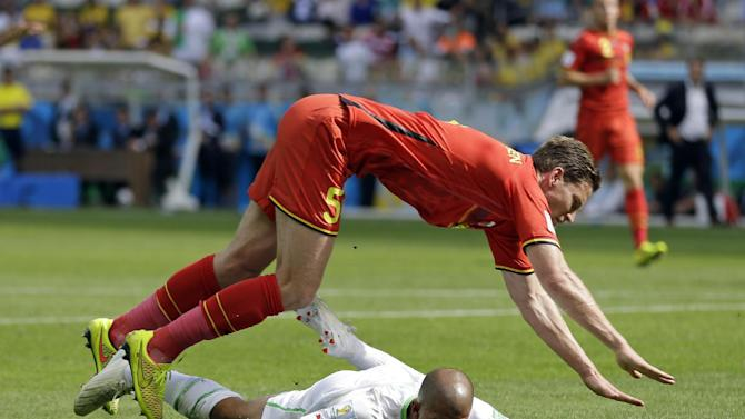 Algeria's Sofiane Feghouli is brought down by Belgium's Jan Vertonghen to get a penalty during the group H World Cup soccer match between Belgium and Algeria at the Mineirao Stadium in Belo Horizonte, Brazil, Tuesday, June 17, 2014
