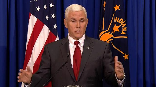 Governor in a political firestorm over Indiana law