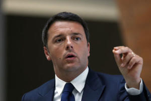 Italy's PM Renzi speaks during a meeting with businessmen at the Shanghai Italy Center in Shanghai