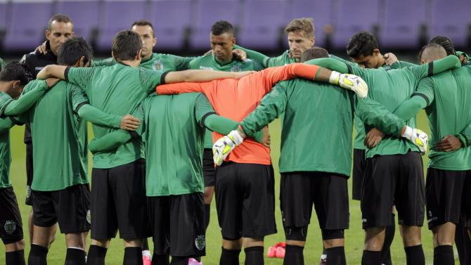 Sporting's players attend a training session on the eve of their Champions League match against NK Maribor at the stadium in Maribor