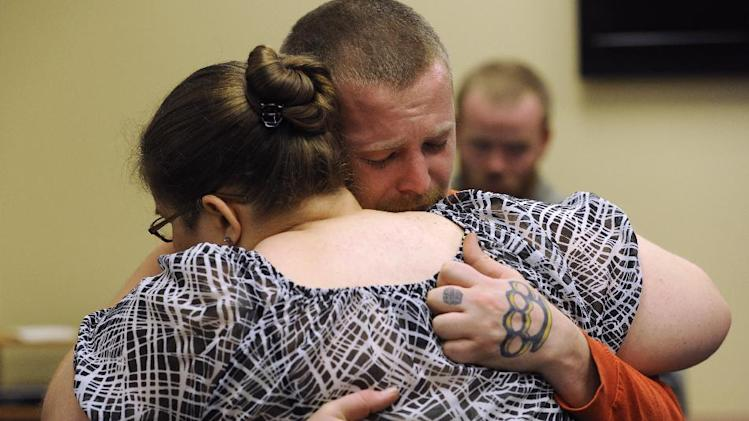 After giving the interview, Jessica's mother Sarah Ridgeway and Jessica's father, Jeremiah Bryant embrace at the Westminster Police Department in Westminster, Colo., on Tuesday, Oct. 9, 2012. The family of Jessica Ridgeway gathered to talk about Jessica and ask for her safe return. Jessica went missing Friday while on her way to school. (AP Photo/The Denver Post, Kathryn Scott Osler, Pool)