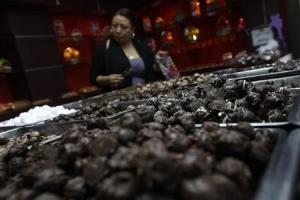 A woman buys chocolate from a store in Polanco neighborhood in Mexico City