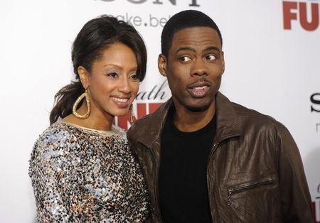 """Cast member Chris Rock and wife Malaak Compton attend the premiere of the film """"Death at a Funeral"""" in Los Angeles"""