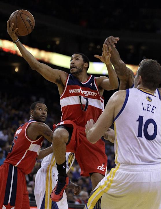 Washington Wizards' Garrett Temple (17) lays up a shot past Golden State Warriors' David Lee (10) during the second half of an NBA basketball game Tuesday, Jan. 28, 2014, in Oakland, Calif