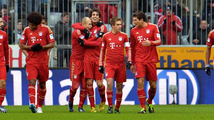 Bayern's players celebrate after scoring   during the German first division Bundesliga soccer match between FC Bayern Munich and SV Werder Bremen  in Munich, Germany, Saturday, Feb. 23, 2013. (AP Photo/Kerstin Joensson)