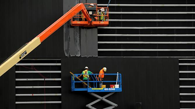 FILE - In this Aug. 13, 2013, file photo, construction workers attach black anodized aluminum panels to the facade of the Owensboro Convention Center's west wall in Oeensboro, Ky. The National Association of Home Builders reports on its index of confidence among U.S. homebuilders for August Thursday Aug. 15, 2013. (AP Photo/The Messenger-Inquirer, Gary Emord-Netzley, File)