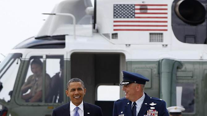 President Barack Obama walks from Marine One with  Col. Michael Minihan to board  Air Force One, Monday, June 25, 2012, at Andrews Air Force Base, Md., en route to New Hampshire. (AP Photo/Carolyn Kaster)