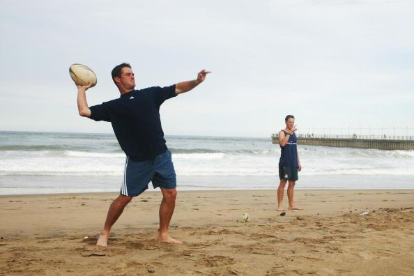 13 Mar 2002:  Mark Boucher of South Africa joins the other cricketers playing touch rugby on the beach in Durban, South Africa. DIGITAL IMAGE.  Touchline photo images are available to clients in UK, U