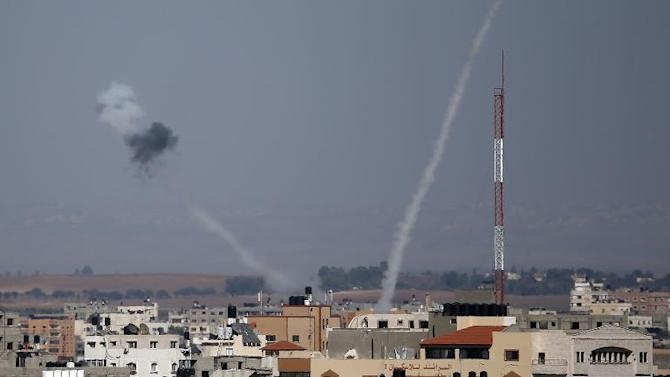 Smoke from rockets fired from Gaza City are seen after being launched toward Israel on July 17, 2014