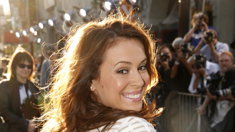 "Alyssa Milano arrives at the LA premiere of ""42"" at the TCL Chinese Theater on Tuesday, April 9, 2013 in Los Angeles. (Photo by Todd Williamson /Invision/AP)"