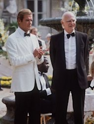 Actors Roger Moore (L) and Willoughby Gray stand together on the set of the 14th James Bond film &quot;A View to a Kill&quot; in Chantilly, France in 1984. Bond fans on Friday celebrated 50 years of the suave British spy&#39;s adventures on the silver screen with a day of 007-themed events around the world
