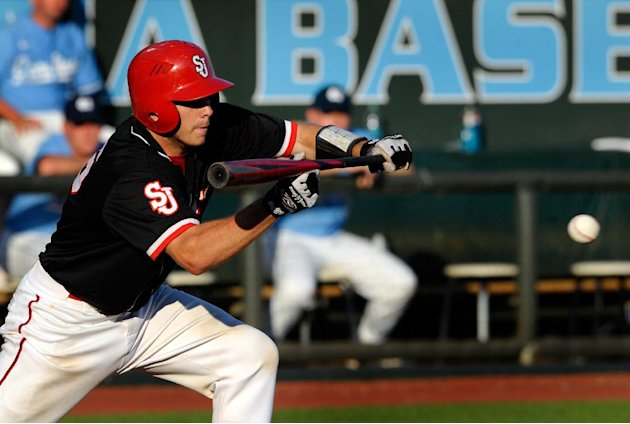 St. John's Dan Roland (6) bunts during the third inning of an NCAA regional tournament college baseball game against North Carolina, Sunday, June 3, 2012, in Chapel Hill, N.C. St. John's won 9-5. (AP