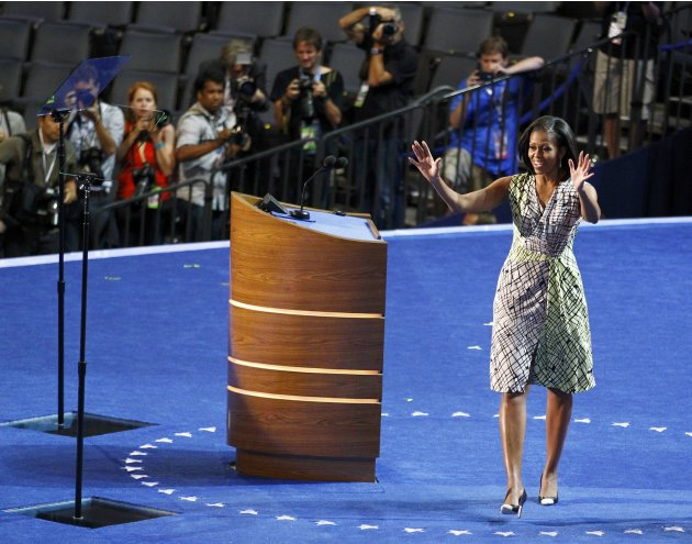 U.S. first lady Michelle Obama gestures as she tours the stage and podium a day before her speech to the Democratic National Convention in Charlotte, Nouth Carolina, September 3, 2012.