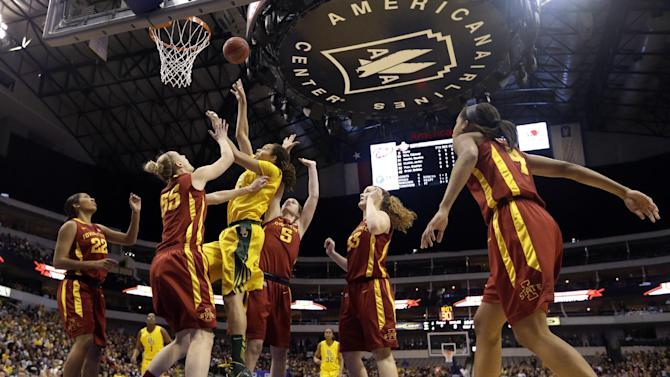 Baylor's Brittney Griner, third from left, shoots against Iowa State' Brynn Williamson (22), Anna Prins (55), Hallie Christofferson (5), Chelsea Poppens (33) and Nikki Moody (4) in the first half of their NCAA college basketball championship game in the Big 12 Conference tournament, Monday, March 11, 2013, in Dallas. (AP Photo/Tony Gutierrez)