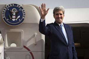 U.S. Secretary of State John Kerry waves at the top of the stairs as he boards his plane to head back to the United States in Riyadh, Saudi Arabia