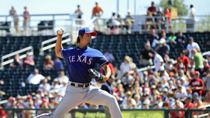 Texas Rangers' Yu Darvish, from Japan, pitches against the Cleveland Indians in the first inning of a spring training baseball game Tuesday, March 13, 2012, in Goodyear, Ariz. (AP Photo/Ross D. Franklin)