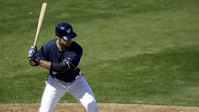 Milwaukee Brewers' Ryan Braun hits during a spring training baseball game against the San Francisco Giants, Sunday, March 4, 2012, in Phoenix. (AP Photo/Morry Gash)