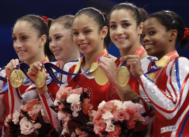 USA's gymnasts, from left, Jordyn Wieber, McKayla Maroney, Sabrina Vega, Alexandra Raisman and Gabrielle Douglas, celebrate on the podium winning the women's team final at  the Artistic Gymnastics Wor
