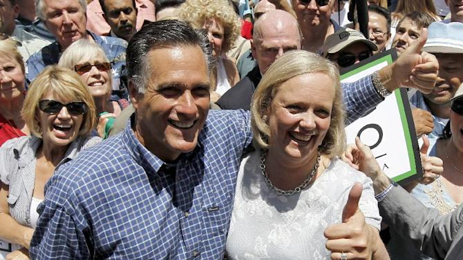 FILE - In this June 5, 2010 file photo, former Massachusetts Gov. Mitt Romney stands with Meg Whitman, then a candidate for the Republican nomination for Californian Gov., in Fullerton, Calif. When Republican presidential candidate Mitt Romney picks his running mate, odds are he'll select someone with far less wealth than his own. Unless he chooses Hewlett-Packard CEO Meg Whitman, one of the richest women in America. Some of the potential Republican vice presidential nominees are grappling with the same financial issues as many of their countrymen. (AP Photo/Chris Carlson, File)