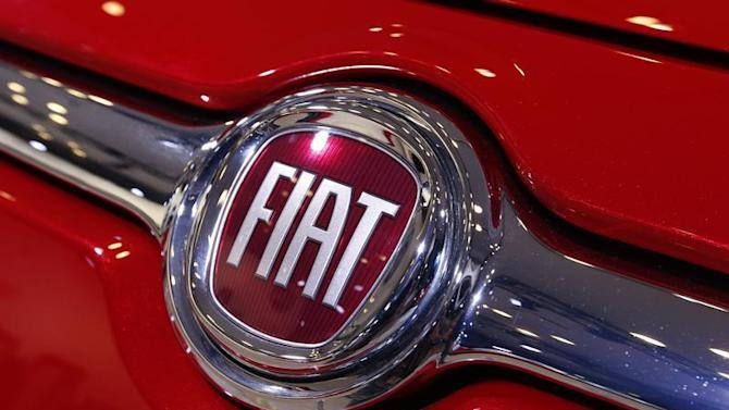 A Fiat logo is seen on a car during a press preview at the 2013 New York International Auto Show in New York