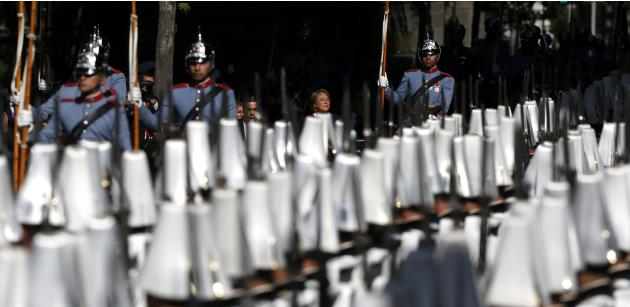 Chile's President Bachelet inspects the honor guard as she arrives at the Santiago's Cathedral