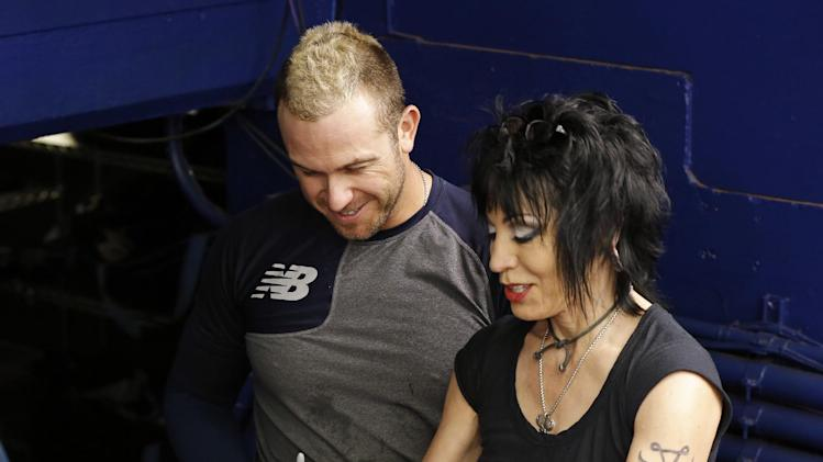 Musician Joan Jett, right, signs a bat for Tampa Bay Rays' Evan Longoria prior to a baseball game against the Toronto Blue Jays Saturday, July 12, 2014, in St. Petersburg, Fla. Jett is performing a concert at Tropicana Field following the game. (AP Photo/Mike Carlson)