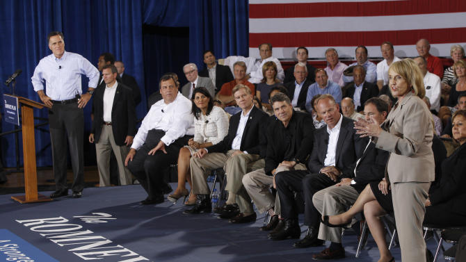 Republican presidential candidate and former Massachusetts Gov. Mitt Romney, left, listens as Arizona Gov. Jan Brewer, right, speaks as he campaigns with Republican governors at Basalt Public High School, in Basalt, Colo., Thursday, Aug. 2, 2012. Pictured from left to right: New Jersey Gov. Chris Christie; South Carolina Gov. Nikki Haley; Virginia Gov. Bob McDonnell; Louisiana Gov. Bobby Jindal; Texas Gov. Rick Perry; Wyoming Gov. Matt Mead; Utah Gov. Gary Herbert; New Mexico Gov. Susana Martinez; Arizona Gov. Jan Brewer. (AP Photo/Charles Dharapak)