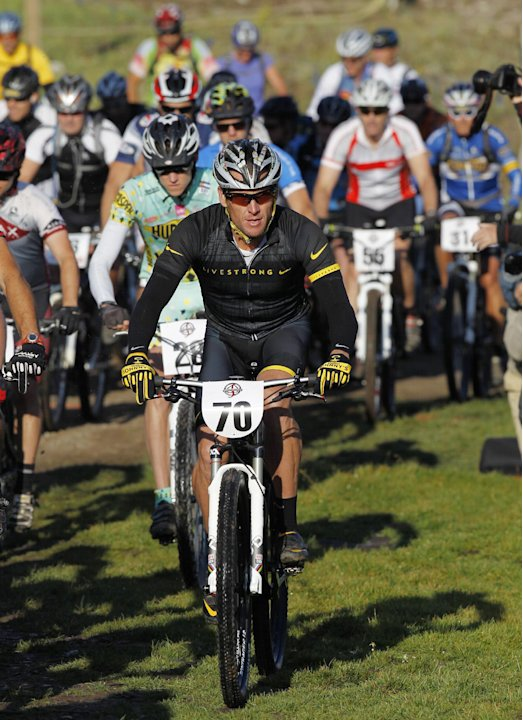 Lance Armstrong takes part in the Power of Four mountain bicycle race at the starting line in Snowmass Village, Colo., early Saturday, Aug. 25, 2012. The race is the first public appearance for Armstr