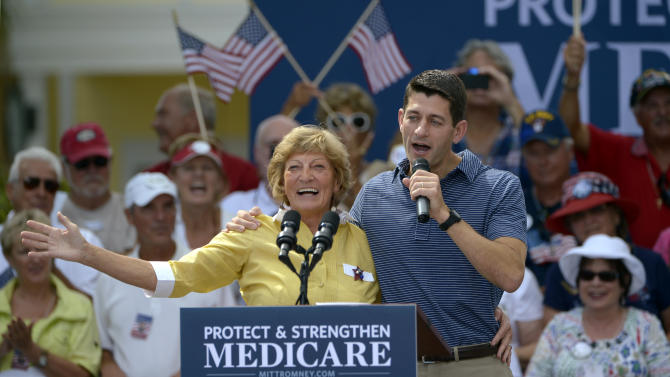 Republican vice-presidential candidate, Rep. Paul Ryan, R-Wis., right, introduces his mother, Betty Ryan Douglas, to supporters at a campaign rally in The Villages, Fla., Saturday, Aug. 18, 2012. (AP Photo/Phelan M. Ebenhack)