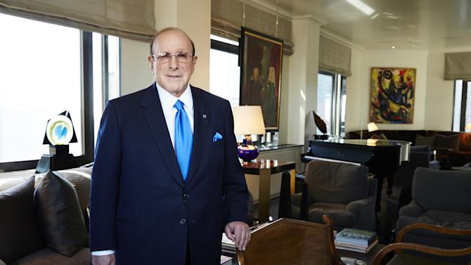 """This Feb. 18, 2013 photo shows Sony Music Entertainment's Chief Creative Officer and famous hitmaker Clive Davis posing for a portrait in New York. Davis' autobiography, """"The Soundtrack of My Life"""" . The 551-page book features behind-the-scene stories of Davis' work with top acts from Bruce Springsteen to Aretha Franklin to Whitney Houston. (Photo by Dan Hallman/Invision/AP)"""