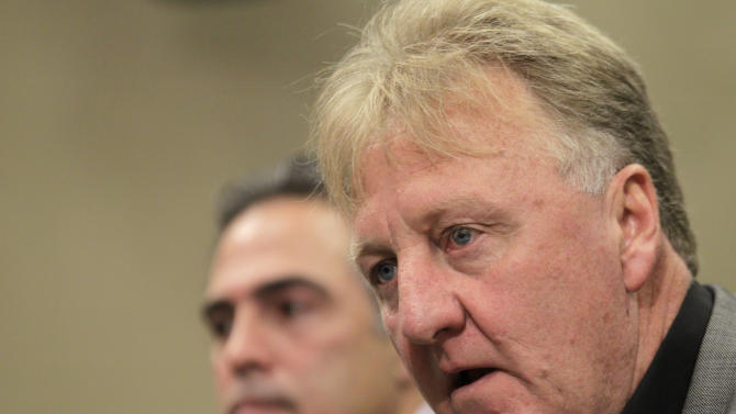 Larry Bird, right, talks about stepping down as president of the Indiana Pacers  as new general manager Kevin Pritchard  listens during an announcement by the NBA basketball team in Indianapolis, Wednesday, June 27, 2012. Donnie Walsh was named as president. (AP Photo/Michael Conroy)