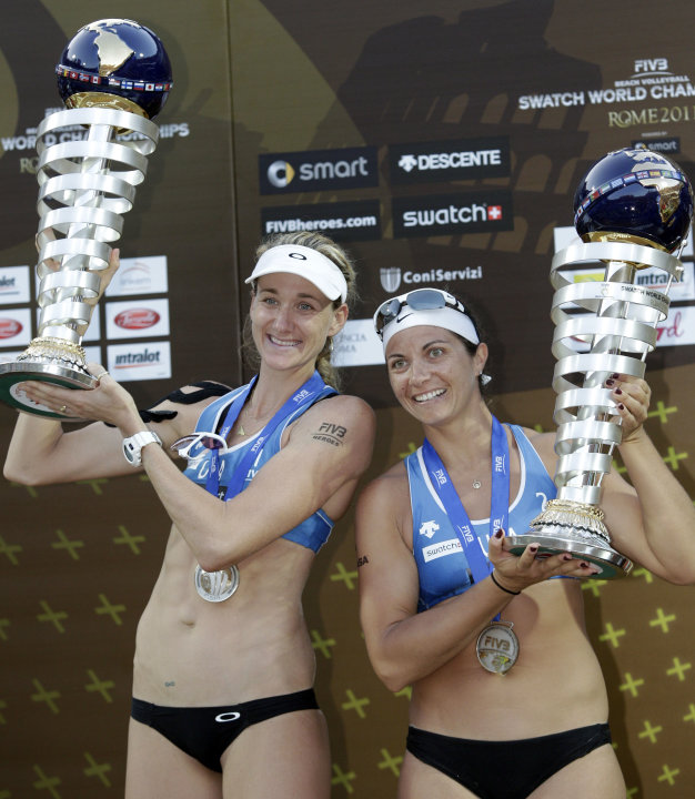 U.S. team Kerri Walsh, left, and Misty May-Treanor, hold the trophies after placing second at the beach volleyball World Championships in Rome, Sunday, June 19, 2011. (AP Photo/Pier Paolo Cito)