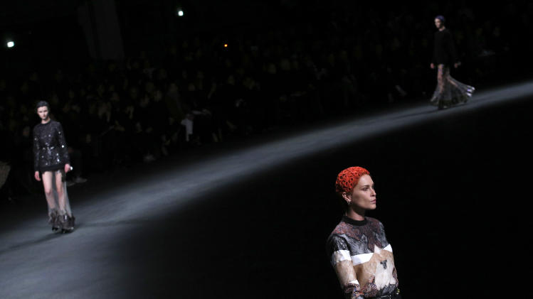 Models wear creations by designer Riccardo Tisci for Givenchy as part of his Fall/Winter 2013-2014 ready to wear collection, in Paris, Sunday, March, 3, 2013. (AP Photo/Christophe Ena)