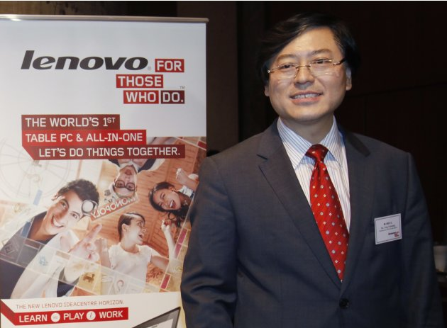 Lenovo Chairman and CEO Yang poses before a news conference on the company's annual results in Hong Kong
