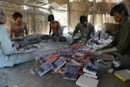 Workers assemble firecrackers at a workshop on the outskirts of Ahmedabad last week ahead of Diwali festivities. The Indian government is bidding to boost the economy with a slew of reforms in retail, aviation and broadcasting