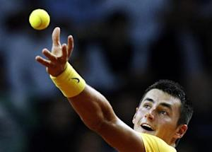Australia's Bernard Tomic serves the ball to Poland's Lukasz Kubot during their Davis Cup play-off tennis match in Warsaw