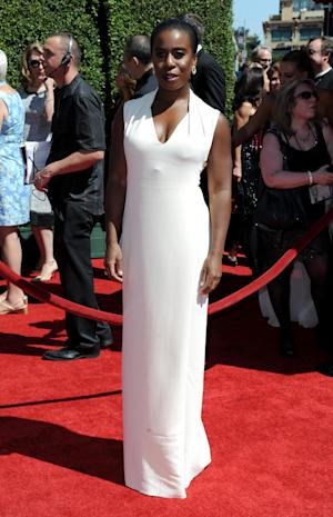 Uzo Aduba arrives at the 2014 Creative Arts Emmys at Nokia Theatre L.A. LIVE on Saturday, Aug. 16, 2014, in Los Angeles. (Photo by Richard Shotwell/Invision/AP)