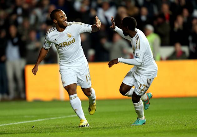 Wayne Routledge, left, bagged a brace as Swansea downed high-flying West Brom