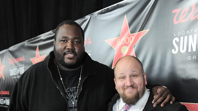 From left, Quinton Aaron and Stephen Kramer Glickman attend Walgreens 8000th Store Opening, on Friday Nov. 30, 2012, in Los Angeles. (Photo by Jordan Strauss/Invision for Walgreens/AP Images)