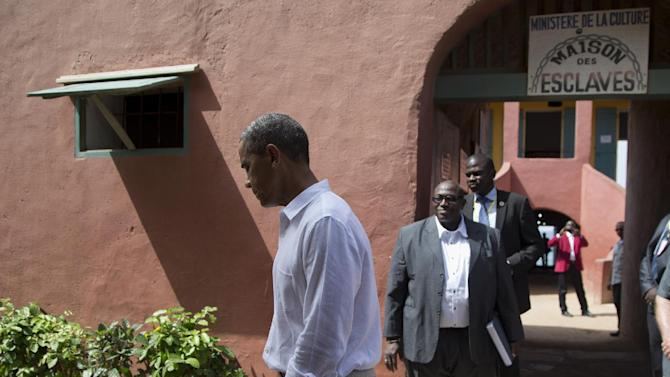 President Barack Obama leaves after talking about his tour of Goree Island, Thursday, June 27, 2013, in Goree Island, Senegal. Goree Island is the site of the former slave house and embarkation point built by the Dutch in 1776, from which slaves were brought to the Americas. (AP Photo/Evan Vucci)