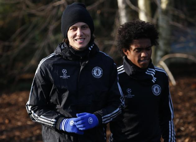 Chelsea's David Luiz and Willian walk to a training session at the team training facility in Stoke D'Abernon to the south of London